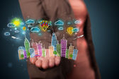 Young woman presenting colorful hand drawn metropolitan city — Stock Photo