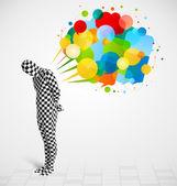 Tipo raro en morphsuit mirando las burbujas coloridas discurso — Foto de Stock