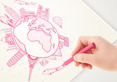 Viaje de vacaciones dibujo alrededor de la tierra con hitos y c la mano — Foto de Stock