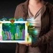 Young person showing tablet with hand drawn cityscape — Stock Photo