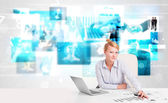 Business person at desk with modern tech images at background — Photo
