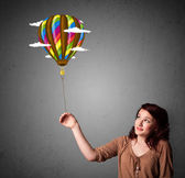 Woman holding a balloon drawing — Stock Photo