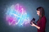Photographer girl making photos with powerful light beam — Stockfoto