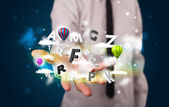 Young businessman presenting magical clouds with letters and bal — Stock Photo