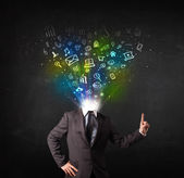 Business man with glowing media icons exploding head  — Stock Photo