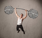 Muscular man fighting with stress — Stock Photo
