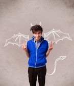 Young man with devil horns and wings drawing — Stock Photo