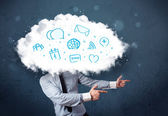 Man in suit with cloud head and blue icons — Stock Photo