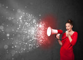 Woman shouting into megaphone and glowing energy particles explo — Stok fotoğraf