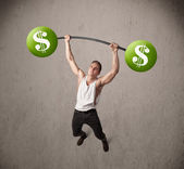 Muscular man lifting green dollar sign weights — Foto Stock
