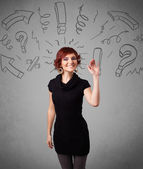 Cute young girl with question sign doodles — Stock Photo