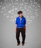 Casual young man with abstract white media icon doodles — Stock Photo