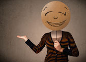 Young woman holding a smiley face board — Stock Photo