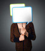 Young woman holding speech bubble — Stock Photo