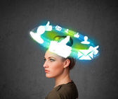 Young teenager with cloud social icons around her head — Stock Photo