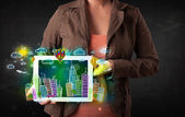 Young person showing tablet with hand drawn cityscape — Stockfoto