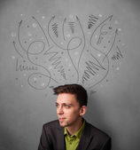 Businessman thinking with arrows over his head — Stock Photo