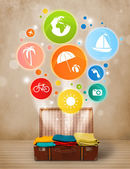 Suitcase with colorful summer icons and symbols — Stockfoto
