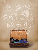 Traveler luggage with hand drawn clothes and icons — Stockfoto