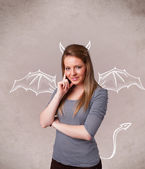 Young girl with devil horns and wings drawing — Stok fotoğraf