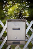 Postbox with white hand drawn mail icons — Stok fotoğraf