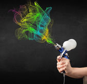 Painter working with airbrush and paints colorful paint — Stock Photo