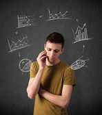 Young man thinking with charts circulation around his head — Foto Stock