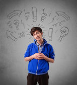 Handome man with question sign doodles — Stock Photo