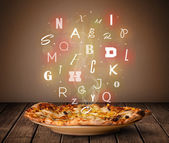 Fresh italian pizza with colorful letters on wood — Stock Photo