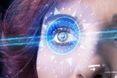 Cyber girl with technolgy eye looking into blue iris — Stock Photo