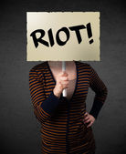 Young woman holding a protest sign — Stock Photo