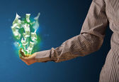 Glowing money in the hand of a businessman — Stock Photo
