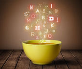 Colorful letters coming out of home cook soup bowl — Stock Photo