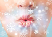 Pretty woman mouth blowing cold breeze — Stock Photo