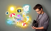 Teenage photographer making photos of holiday painted icons — Stock Photo