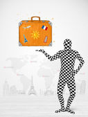 Man in full body suit presenting vacation suitcase — Stock Photo