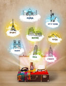 Tourist suitcase with famous landmarks around the world — Stock Photo
