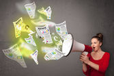 Girl yelling into loudspeaker and newspapers fly out — Stock Photo