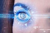 Cyber girl with technolgy eye looking into blue iris — Stock Photo