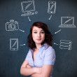 Young woman thinking with drawn gadgets around her head — Stock Photo #51498057