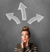 Young woman thinking with arrows above her head — Stock Photo