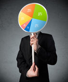 Businessman holding a pie chart — Stock Photo