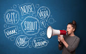 Girl yelling into megaphone and hand drawn speech bubbles come o — Stock Photo