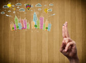 Happy smiley fingers looking at colorful handrawn cityscape — Stock Photo