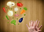 Happy smiley face fingers looking at illustration of colorful he — Stock Photo