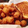 Grilled cheese and tater tots — Stock Photo