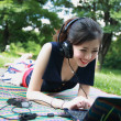 Beautiful teenager listening music on laptop. — Foto de Stock