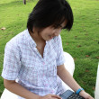 Attractive Asian woman is outdoors with laptop  — Stok fotoğraf