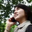 Stock Photo: Womenjoying outdoors while talking on cell phone