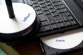 Picture concept pirate discs — Stock Photo